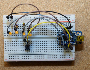 Bracer circuit on a breadboard, using a 3.3V Trinket.